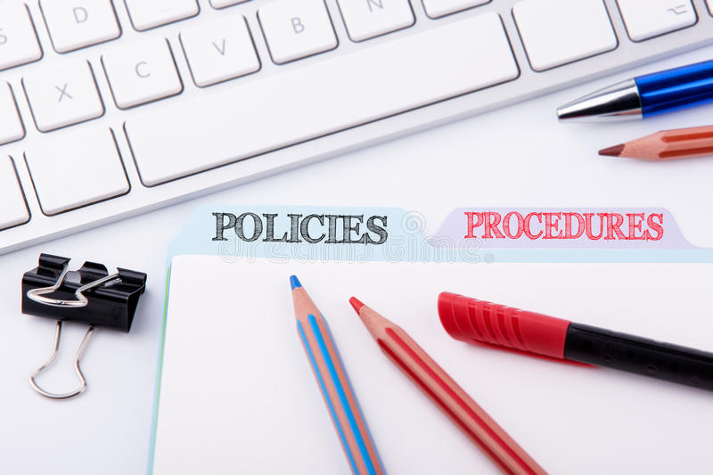 Policies and Procedures. Folder Register on a white Office Table stock photography
