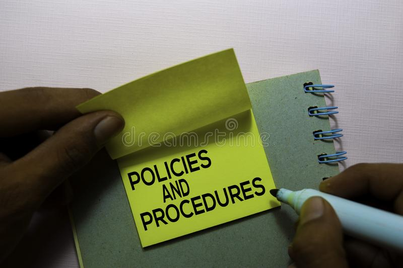 Policies and Procedures text on sticky notes isolated on office desk stock photography