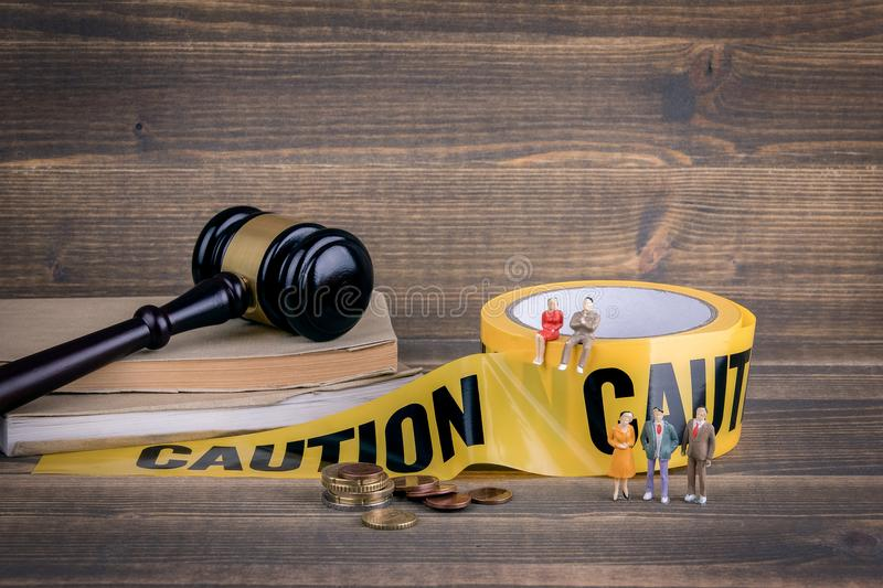 Policies and Procedures. yellow caution tape on a wooden background royalty free stock photo