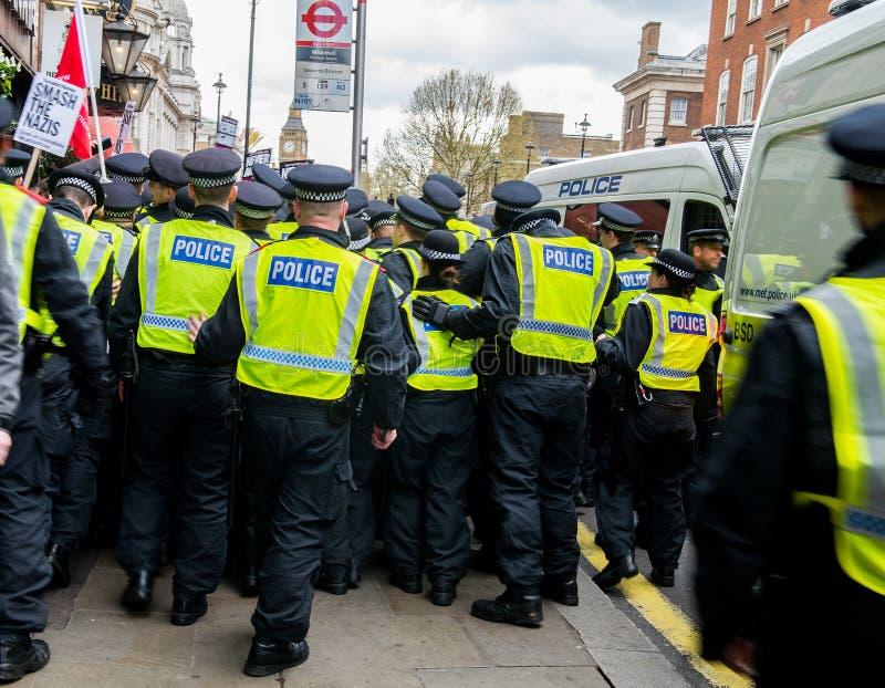 Policja - marsz protestacyjny - Londyn fotografia royalty free