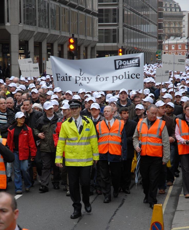 policja uczciwej rekompensaty marszu zdjęcie royalty free