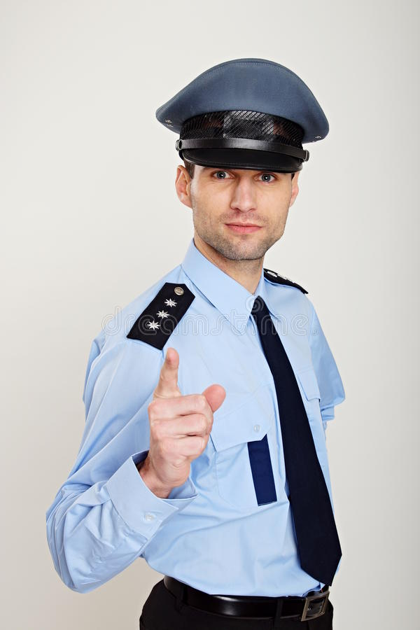 Policjantów przedstawienia na tobie obrazy stock