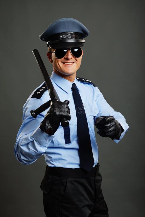 Policjantów przedstawienia na tobie obraz stock