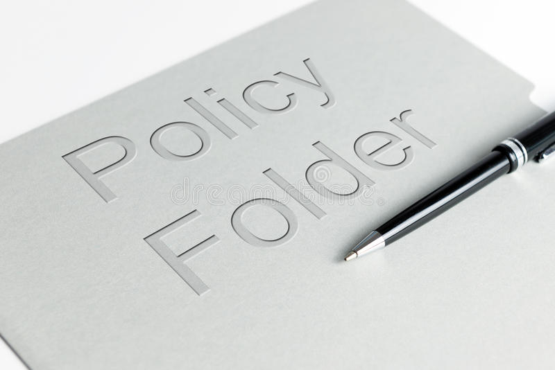 Policy holder. Closeup shot of policy file holder with a pen stock image