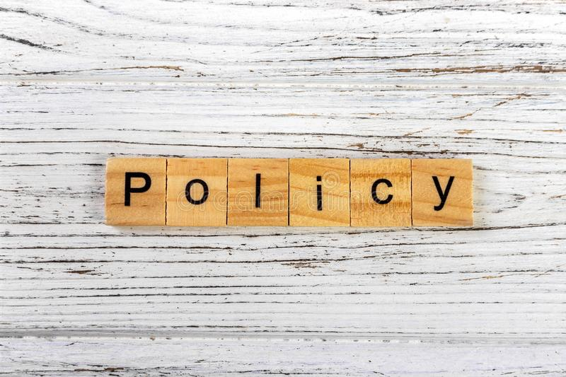 Policy word made with wooden blocks concept.  royalty free stock photos