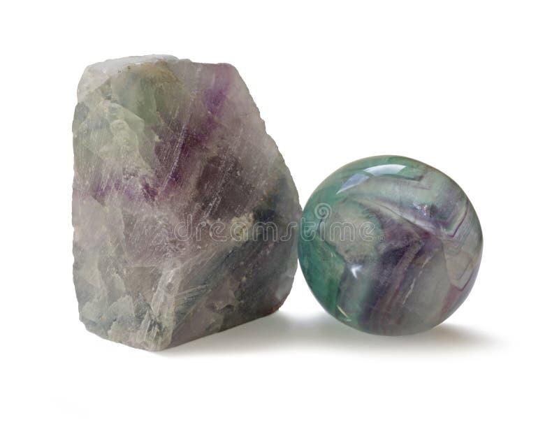 Polier- und raue natürliche Exemplare des Fluorits versahen Kristall mit einem Band stockfoto