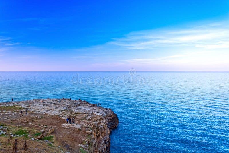 Polignano a Mare, Puglia, Italy. Sunset on the coast Pietra Piatta, Apulia, Italy, province of Bari, beach, southern, sea, landscape, village, tourism, cliff royalty free stock photo