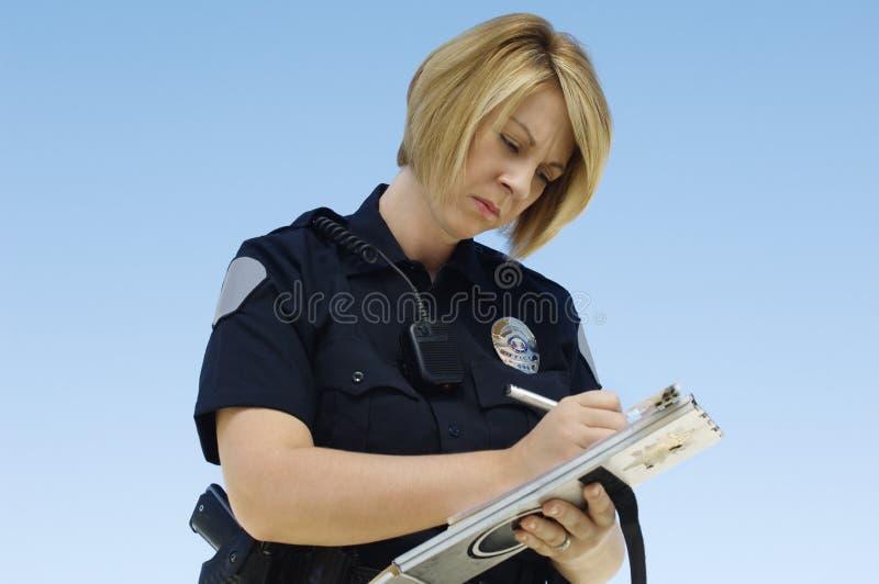Polis Writing Ticket royaltyfri bild