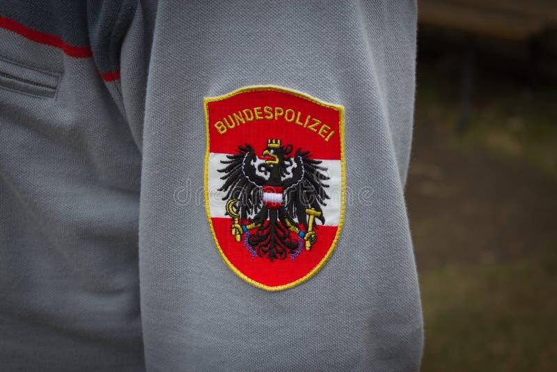 Polisen Österrike, tjänstemannen, polisen förser med märke, emblemet, logoen, federal po arkivfoto