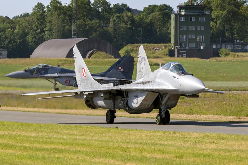 Polish Air Force MiG-29 Fulcrum fighter jets. FLORENNES, BELGIUM - JUN 15, 2017: Polish Air Force MiG-29 Fulcrum fighter jets taxiing towards the runway of royalty free stock photo