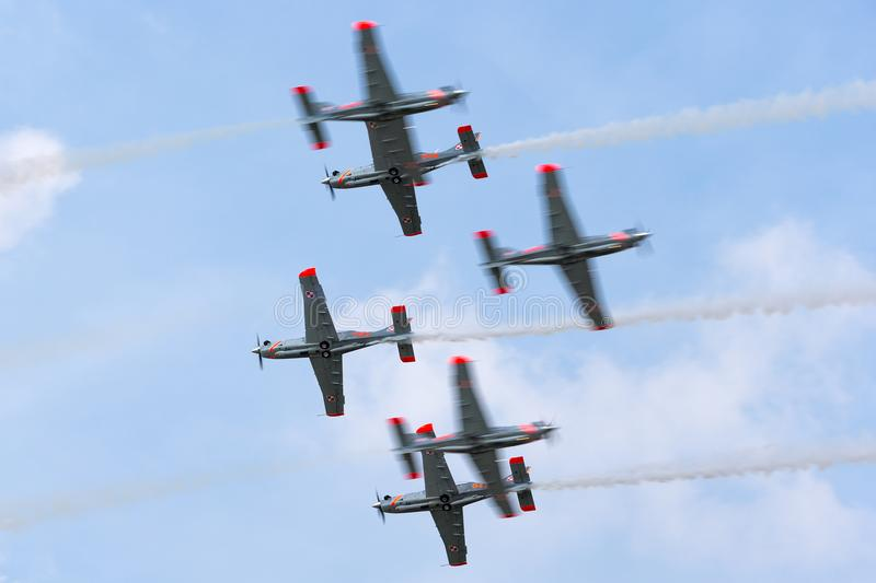 Polish Air Force PZL-Okecie PZL-130 TC-1 Orlik turboprop, single engine, two seat trainer aircraft flying in formation. RAF Fairford, Gloucestershire, UK - July stock images