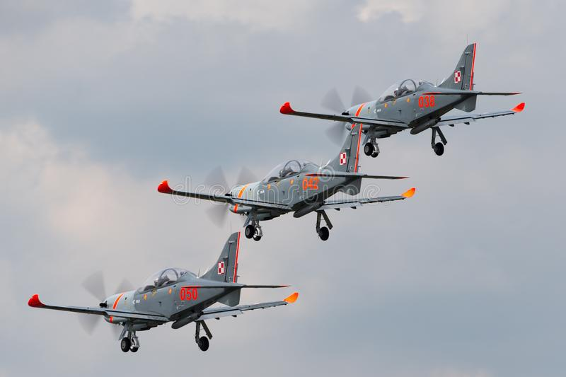 Polish Air Force PZL-Okecie PZL-130 TC-1 Orlik turboprop, single engine, two seat trainer aircraft flying in formation. RAF Fairford, Gloucestershire, UK - July royalty free stock photo
