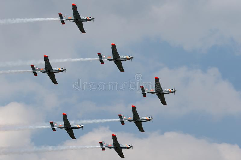 Polish Air Force PZL-Okecie PZL-130 TC-1 Orlik turboprop, single engine, two seat trainer aircraft flying in formation. RAF Fairford, Gloucestershire, UK - July royalty free stock photos