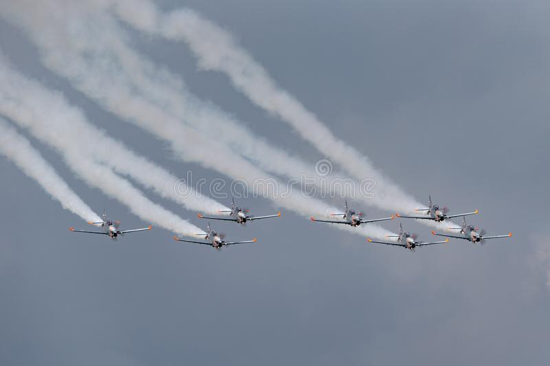 Polish Air Force PZL-Okecie PZL-130 TC-1 Orlik turboprop, single engine, two seat trainer aircraft flying in formation. RAF Fairford, Gloucestershire, UK - July stock photography