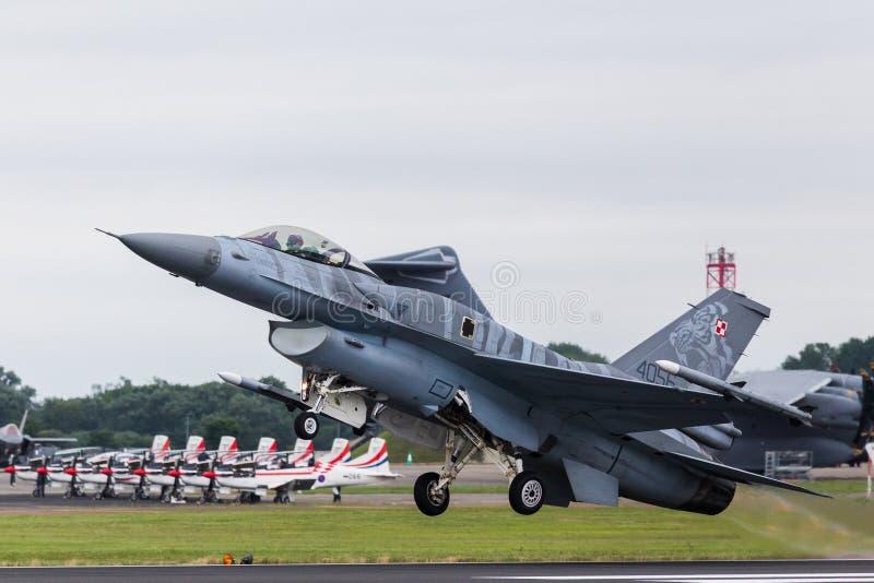 Polish Air Force Tiger Demo F-16C taking off. Captured at the 2016 Royal International Air Tattoo at RAF Fairford royalty free stock photos