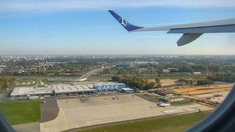 LOT Polish airlines aircraft over Cargo terminal in Chopin airport. stock photo