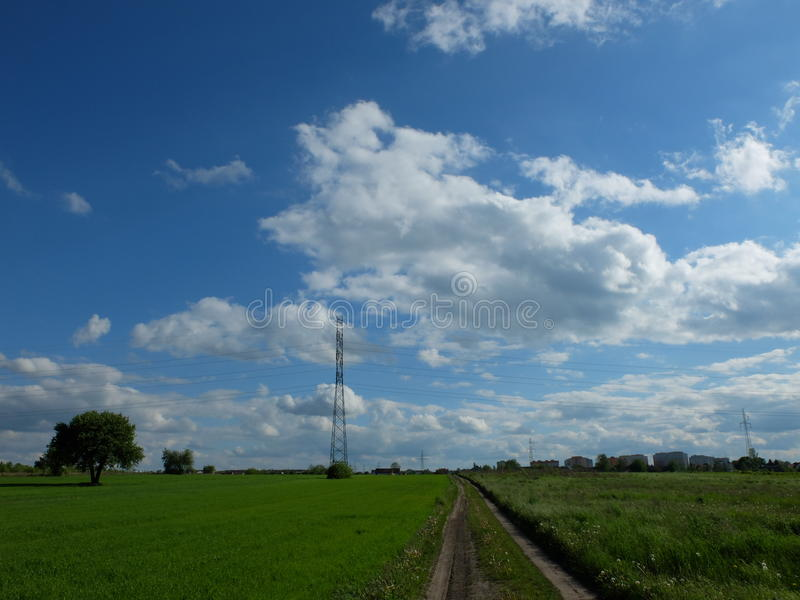 Polish blue sunny sky and green pasture. Sunny blue sky in Poland. Taken in Radom city royalty free stock image