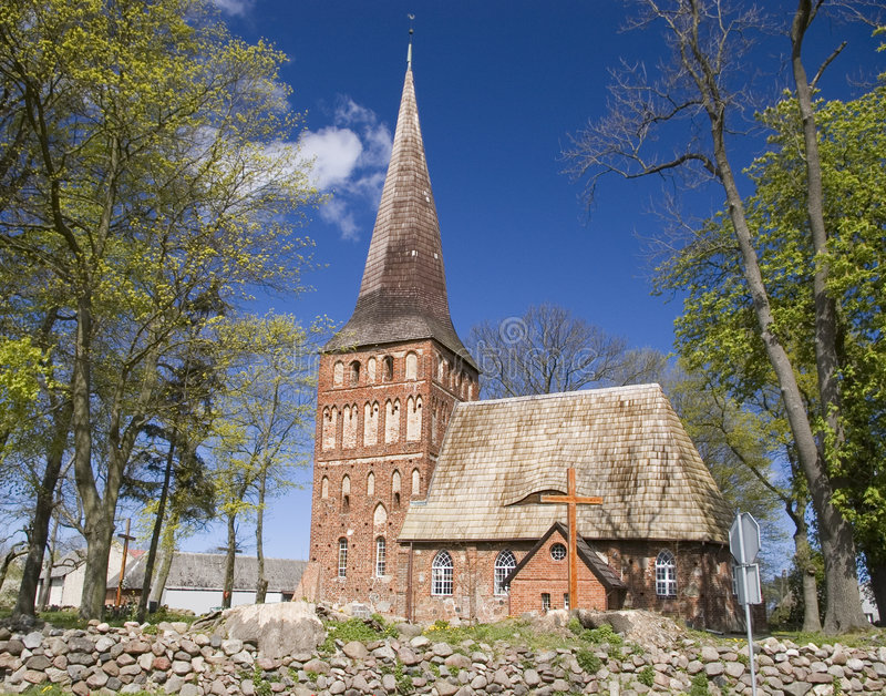 Polish church. A small, village church in Poland. Beautiful Polish countryside. Spring sunny day. Old architecture royalty free stock photo