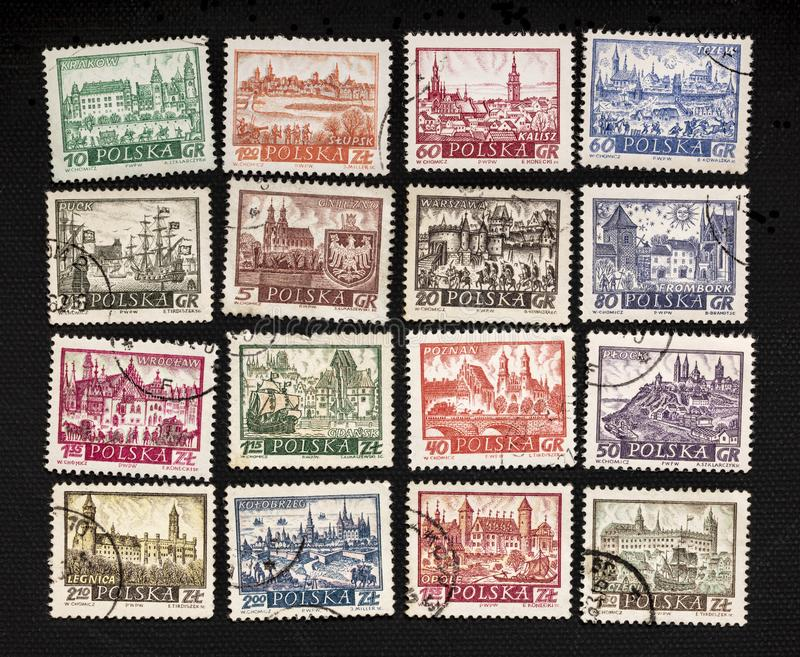 Polish cities on vintage post stamps stock photo
