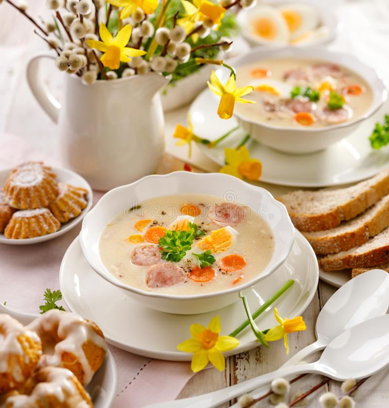 Polish Easter soup, white borscht with the addition of white sausage and a hard boiled egg. Traditional Easter dish in Poland. White borscht, polish Easter soup royalty free stock photography