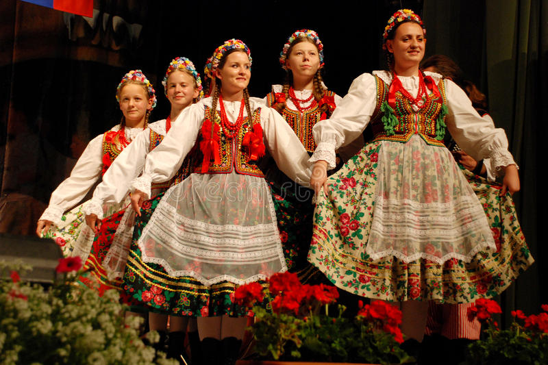 Polish folk dancers at a festival. Polish women folk dancers from a Polish traditional dance ensemble - called MALE SLOWIANKI - Krakow, Poland, dancing at the royalty free stock photo