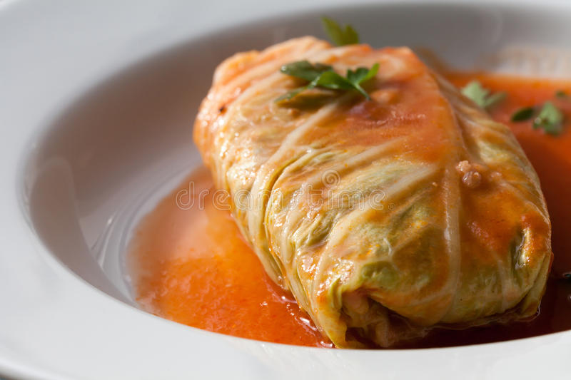 Polish Food. Cabbage rolls roulades, traditional polish food /golabki /with meat, rice, in reach tomato sauce stock photos