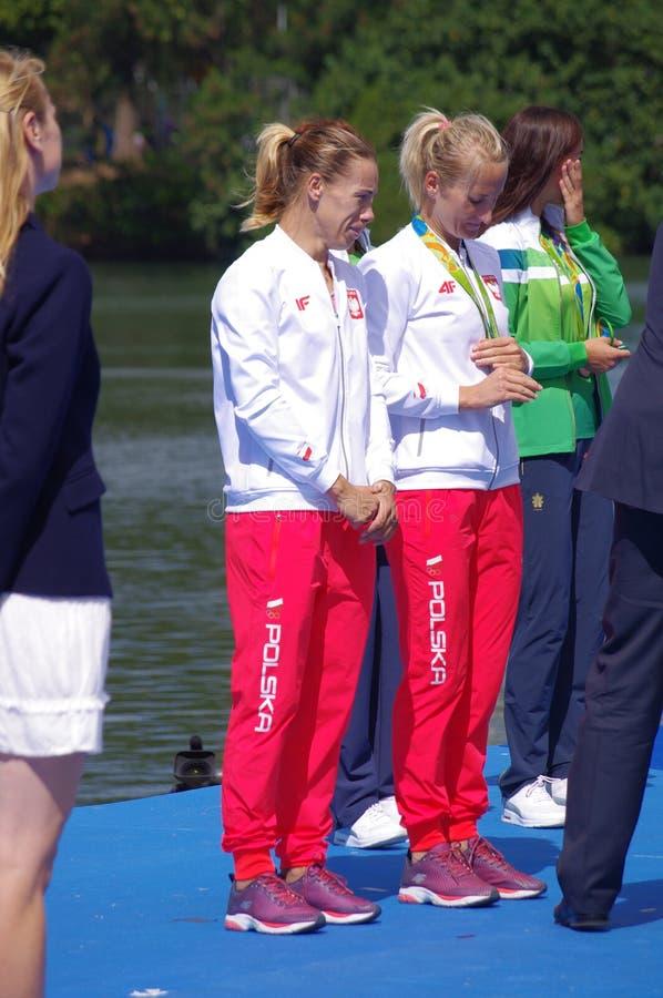 Polish Magdalena Fularczyk-Kozlowska and Natalia Madaj with Olympic gold medals. Women's Double Sculls Magdalena Fularczyk-Kozlowska and Natalia Madaj of Poland royalty free stock images