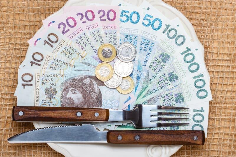Polish money on kitchen table, coast of living stock photo