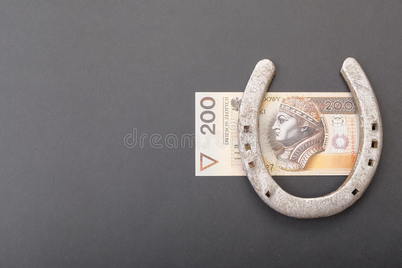 Polish money luck. Horseshoe on a polish two hundred zloty banknote for concepts about money and luck - copy space to the left stock photos