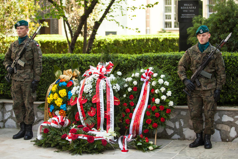 Polish national and public holiday the Constitution Day. KRAKOW, POLAND - MAY 3, 2015: Polish soldiers at ceremony of laying flowers to monument to Hugo Kollataj stock image
