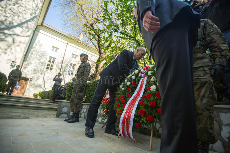 Polish national and public holiday the May 3rd Constitution Day. KRAKOW, POLAND - OCT 3, 2015: Officials at ceremony of laying flowers to the monument to Hugo royalty free stock image