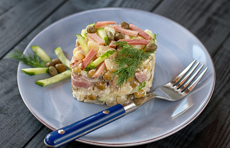 Polish salad with vegetables and capers stock images