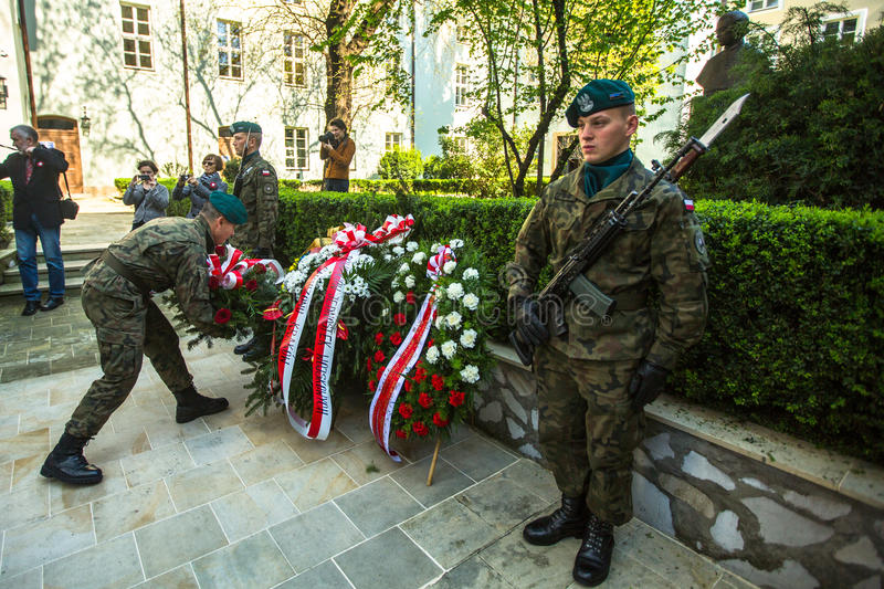 Polish soldiers at ceremony of laying flowers to monument to Hugo Kollataj during annual Polish national. KRAKOW, POLAND - OCT 3, 2015: Polish soldiers at royalty free stock image