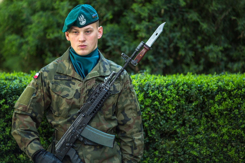 Polish soldiers at ceremony of laying flowers to monument to Hugo Kollataj during annual Polish national and public holiday. KRAKOW, POLAND - OCT 3, 2015: Polish stock image