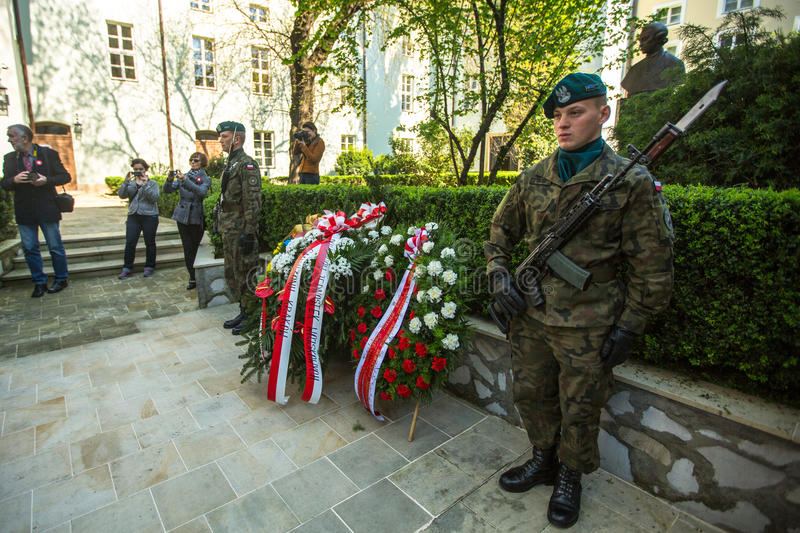 Polish soldiers at ceremony of laying flowers to monument to Hugo Kollataj during annual Polish national and public holiday. KRAKOW, POLAND - MAY 3, 2015: Polish royalty free stock photos