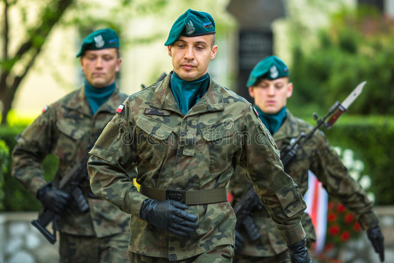 Polish soldiers at ceremony of laying flowers to monument to Hugo Kollataj. KRAKOW, POLAND - MAY 3, 2015: Polish soldiers at ceremony of laying flowers to stock photos