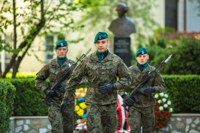 Polish soldiers at ceremony of laying flowers to monument to Hugo Kollataj. KRAKOW, POLAND - MAY 3, 2015: Polish soldiers at ceremony of laying flowers to royalty free stock photos