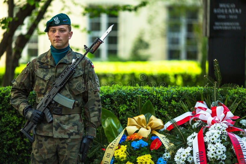 Polish soldiers at ceremony of laying flowers to monument to Hugo Kollataj. KRAKOW, POLAND - OCT 3, 2015: Polish soldiers at ceremony of laying flowers to royalty free stock images