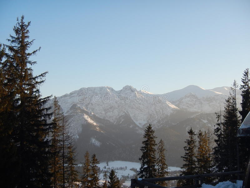 Polish Tatry mountains landscape in winter. Tatry mountains landscape in winter with snow and blue sky. Giewont peek royalty free stock photos