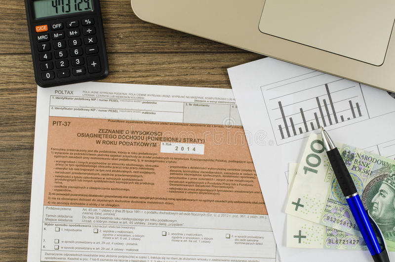 Polish tax form with pen and cash. On wooden table stock photo