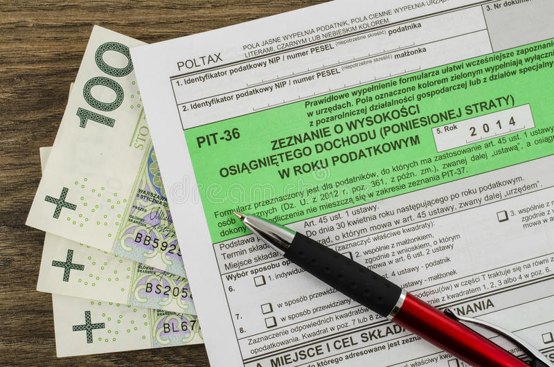 Polish tax form with pen and money. On wooden table stock photography