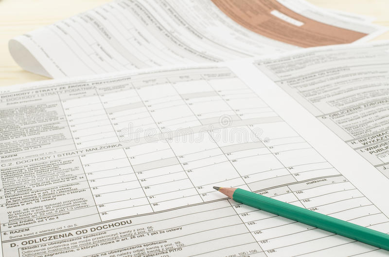 Polish tax form with pencil. On wooden table royalty free stock photos