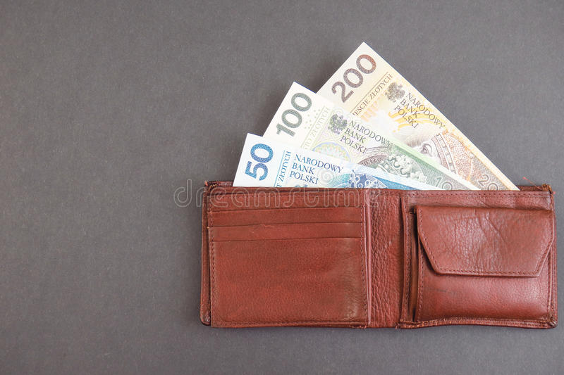 Polish wallet. Zloty banknotes in a purse for your financial, bonus, cashback, gifts and presents concepts - copy space to the left royalty free stock photo