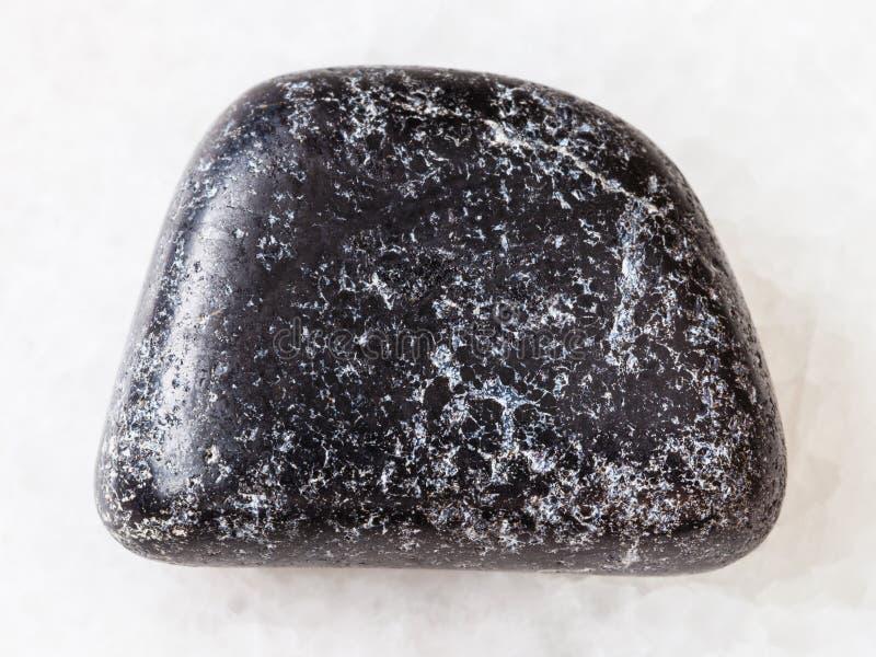 polished Chromite stone on white stock image