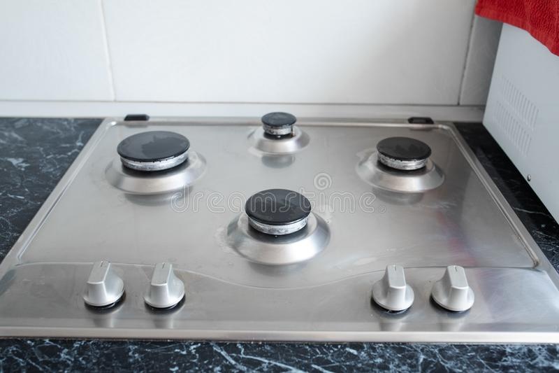 Polished gas cooker after washing.Perfectly clean gas cooker after being washed with polishing chemicals. The result of stock images