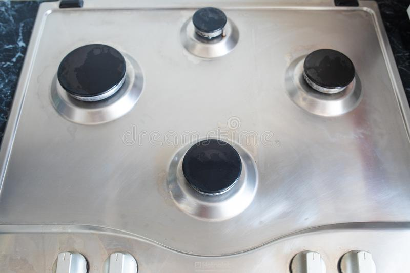 Polished gas cooker after washing.Perfectly clean gas cooker after being washed with polishing chemicals. The result of royalty free stock photos