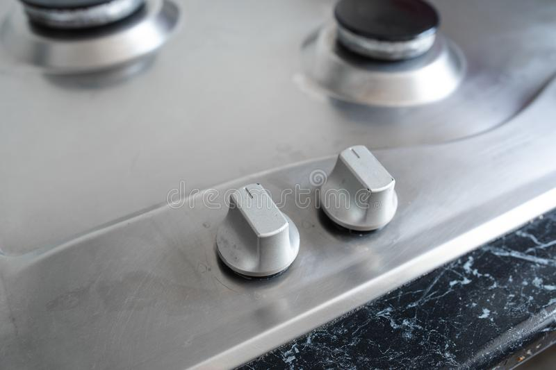Polished gas cooker after washing.Perfectly clean gas cooker after being washed with polishing chemicals. The result of royalty free stock photo