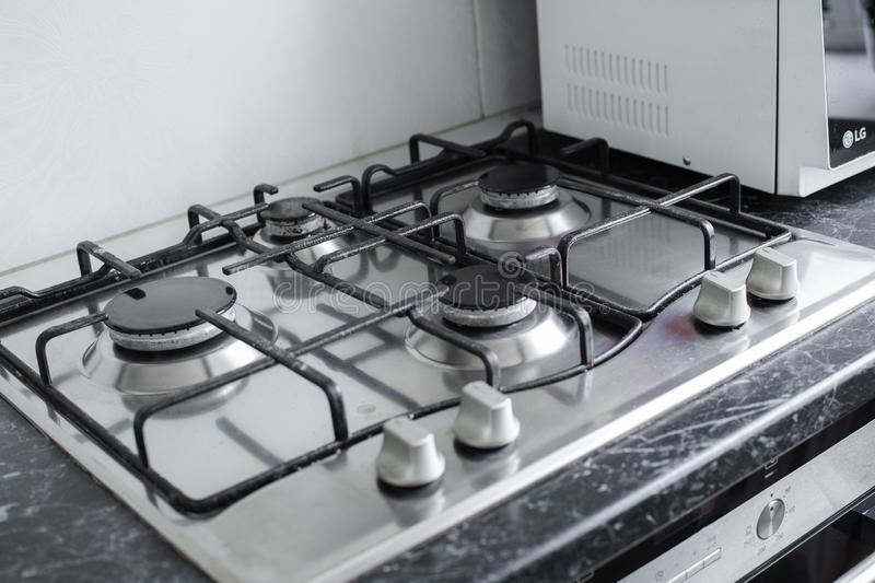 Polished gas cooker after washing.Perfectly clean gas cooker after being washed with polishing chemicals. The result of royalty free stock image