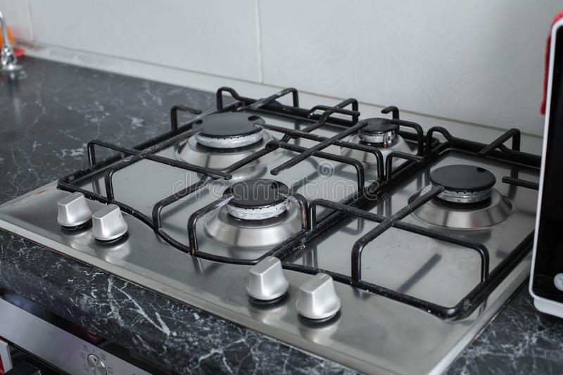 Polished gas cooker after washing.Perfectly clean gas cooker after being washed with polishing chemicals. The result of royalty free stock images