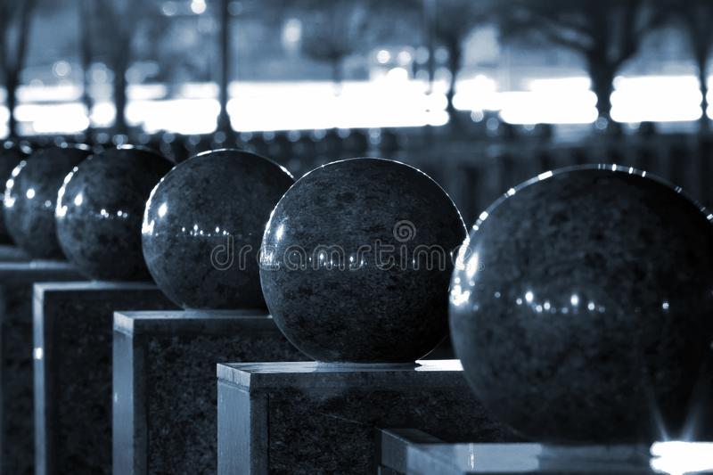 Polished granite balls at night. Abstract detail of urban realm stock photo